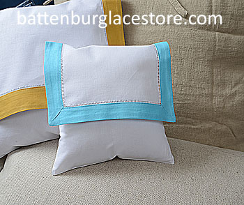 Envelope pillow. 8 inches. White with Aqua color border.