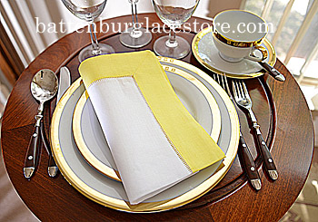Dinner Napkin. Hemstitched border.White with Aurora Yellow.Each.