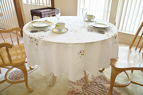 "Rose 68"" Round Tablecloth. White."