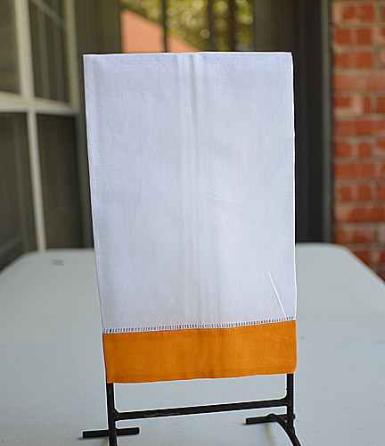Guest towel. White with Hot Orange color border