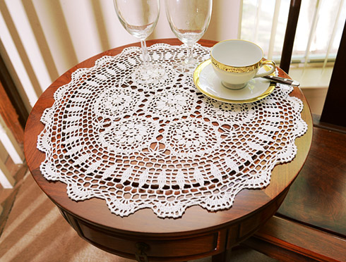 "Crochet Round Placemat. 18"" round. White color. 1 Each."